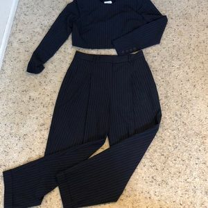 Two piece navy blue pinstriped outfit.